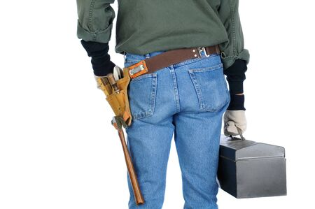 Closeup of a construction worker holding a tool box. Man is view from behind on a white background.  photo