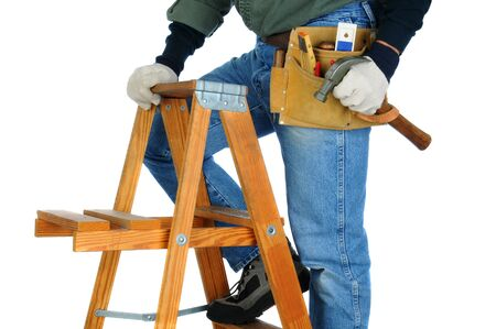 Closeup of a construction worker climbing a ladder with a hammer in his hand. horizontal format on a white background. Man is unrecognizable. photo