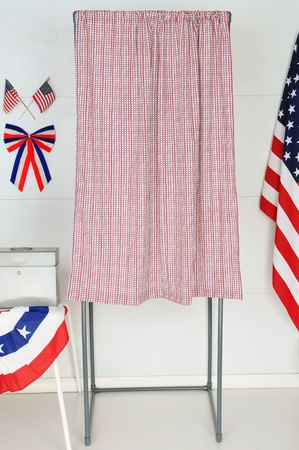 A single voting booth with American flags and bunting with a table and ballot box. photo