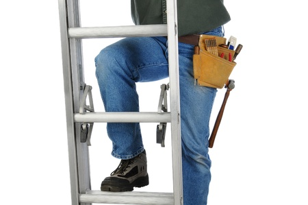 Closeup of a construction worker climbing a ladder. Horizontal format on a white background. Man is unrecognizable. photo