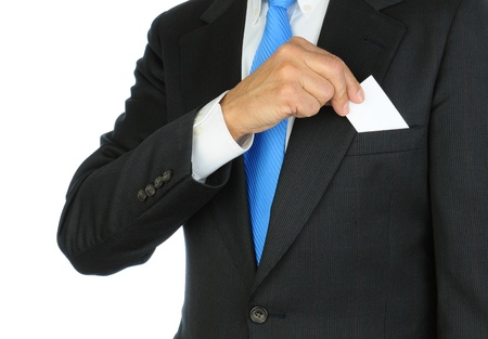breast pocket: Closeup of a businessman taking a business card from the breast pocket of his suit jacket. Hand and torso only, man is unrecognizable. Horizontal format on a white background.