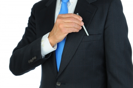 breast pocket: Closeup of a businessman in a suit taking a pen from the breast pocket of his jacket. Torso only, man is unrecognizable. Horizontal format on a white background. Stock Photo