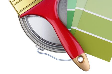 Overhead closeup of painting supplies over a white background. Paintbrush, and paint chips resting on top of a closed paint can. Horizontal format. Stock Photo - 18871409