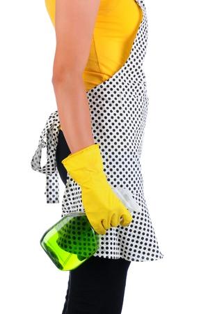 delantal: Vista de perfil de detalle de una dama sosteniendo una botella de aerosol de limpiador químico Formato vertical aislado en blanco Mujer es irreconocible Foto de archivo