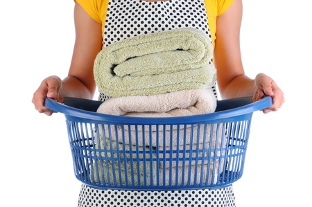 Closeup of a maid holding a laundry basket full of folded towels  Horizontal format over a white background  Woman is unrecognizable Zdjęcie Seryjne - 20204569