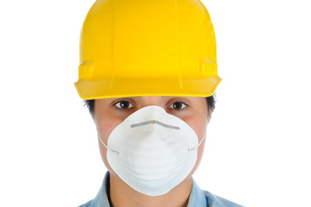 dust mask: Closeup of a female construction worker wearing a yellow hard hat and dust mask. Horizontal format isolated on white.
