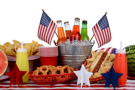 A picnic table set up with a Fourth of July theme photo