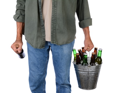 beer bucket: Closeup of a man in jeans carrying a bucket of beer in one hand and a single bottle in the other  Man is unrecognizable, torso and legs only, isolated on white
