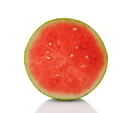 Closeup of a watermelon that has been cut in half  Isolated on white with reflection  photo