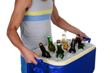ice chest: Closeup of a fit young man carrying an ice chest full of beer  Man iis wearing a tank top showing toso only  Horizontal format isolated on white