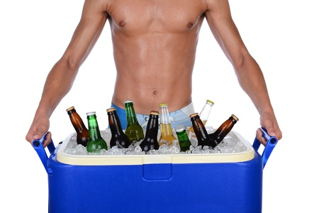 Closeup of a fit young man carrying an ice chest full of beer  Man is shirtless showing torso only  Horizontal format isolated on white