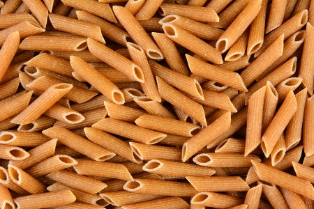 Whole Wheat Penne Rigate closeup  Horizontal format, filling the frame  photo