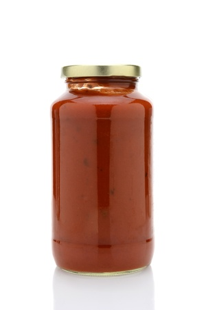 glass jar: Closeup of a jar of spaghetti sauce isolated on white with reflection  Stock Photo