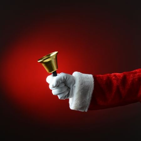 pealing: Santa Claus Ringing a Bell Over a Light to Dark Red Square Format with only Santa