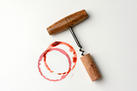 Wine stains cork and corkscrew on paper  Horizontal format  The stains are from wine bottle bottoms and drips  Stock Photo