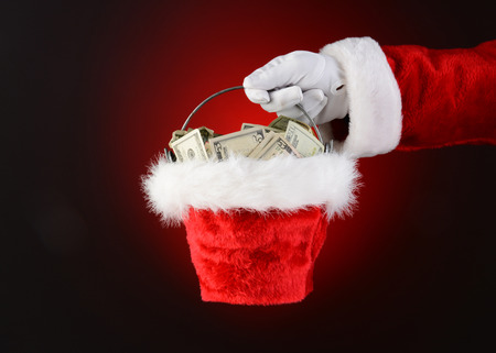 Closeup of Santa Claus holding a bucket of cash  Only Santa photo