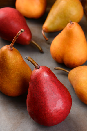 Closeup of Bosc and Red Pears, shallow depth of field with focus on the front piece of fruit. photo