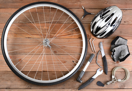 bicycle helmet: Overhead view of bicycle gear laid out on a rustic wooden floor   Stock Photo