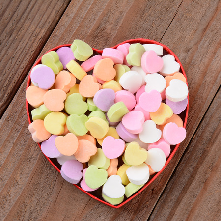 heart shaped box filled with Valentine candy photo
