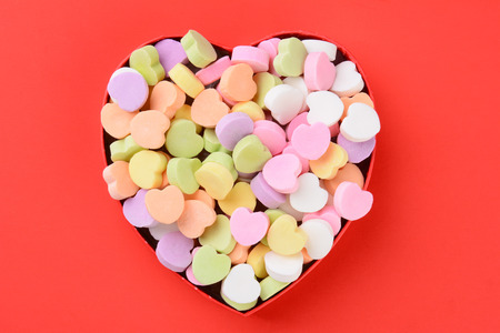 heart shaped box filled with Valentine candy Stock Photo