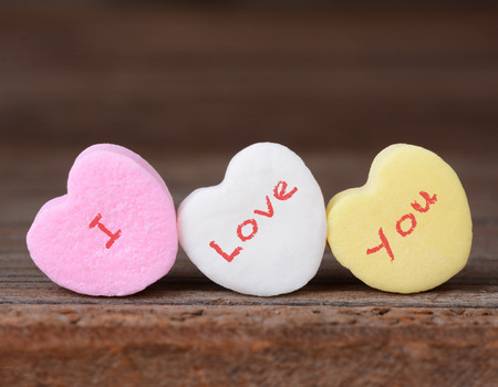 Closeup of the words I Love You spelled out on candy hearts Stock Photo