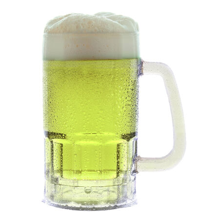 A cold frothy mug of green beer photo