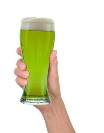 Man hold a green beer glass photo