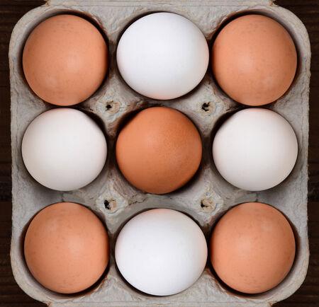 carton of brown and white farm fresh eggs photo