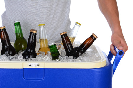 ice chest: Closeup of a fit young man carrying an ice chest full of beer
