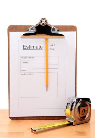 Closeup of a Contractors estimate form with a pencil and tape measure on a wooden table Stockfoto