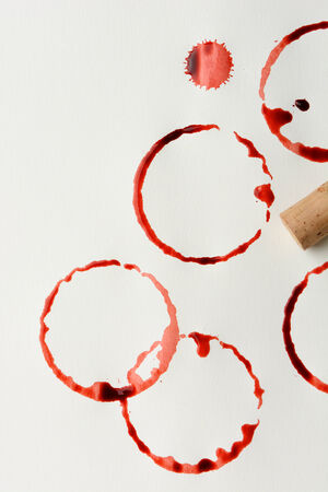 Wine stains and cork on paper. Fills the frame in vertical format. The stains are from a bottle bottom and drips. photo