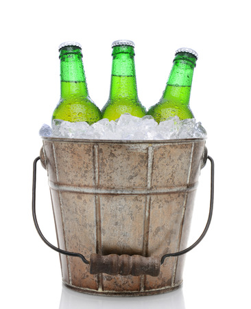 beer bucket: Closeup of an old fashioned beer bucket with three green bottles of cold beer. Isolated on white with reflection.