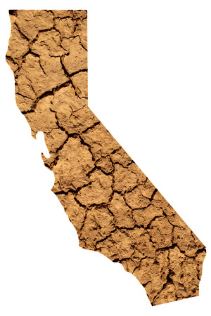 Map shape of California with dry parched earth representing drought conditions due to Climate Change also know as Global Warming.