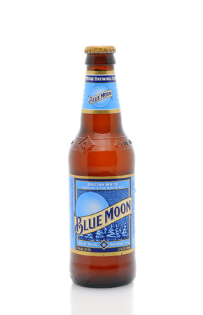 ounce: IRVINE, CA - January 11, 2013: A 12 ounce bottle of Blue Moon Belgian White Ale. Blue Moon Brewing Co. is a part of Tenth and Blake Beer Company, the craft and import division of Chicago-based MillerCoors.
