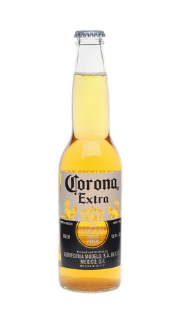 the corona: IRVINE, CA - January 11, 2013: Photo of a 12 ounce bottle of Corona Extra Beer. Corona, produced by Grupo Modelo with Anheuser Busch InBev, is the most popular imported beer in the US.