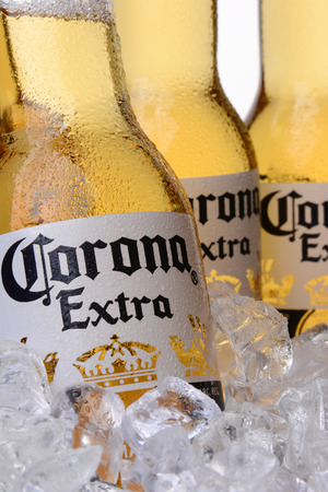 IRVINE, CA - MAY 30, 2014: Closeup of Corona Extra Beer bottles in ice. Corona from Grupo Modelo, Anheuser-Busch InBev is the most popular imported beer in the US.