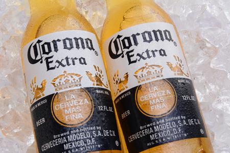IRVINE, CA - MAY 27, 2014: Two bottles of Corona Extra Beer on a bed of ice. Corona from Grupo Modelo, Anheuser-Busch InBev is the most popular imported beer in the US.