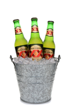 especial: IRVINE, CA - MAY 25, 2014: Three Bottles of Dos Equis Lager Especial in a bucket of ice. Founded in 1890 from the Cuauhtemoc-Moctezuma Brewery in Monterrey, Mexico a subsidary of Heineken International.