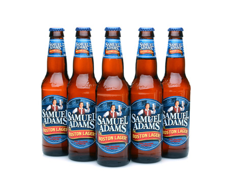 adams: IRVINE, CA - MAY 25, 2014: Five bottles of Samuel Adams Boston Lager on white. Brewed by the Boston Beer Company one of the largest American-owned beermakers.