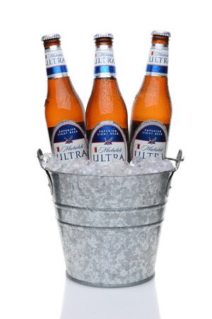 carbohydrates: IRVINE, CA - MAY 25, 2014: Michelob Ultra bottles in a bucket of ice. Introduced in 2002 Michelob Ultra is a light beer with reduced calories and carbohydrates, from Anheuser-Busch.