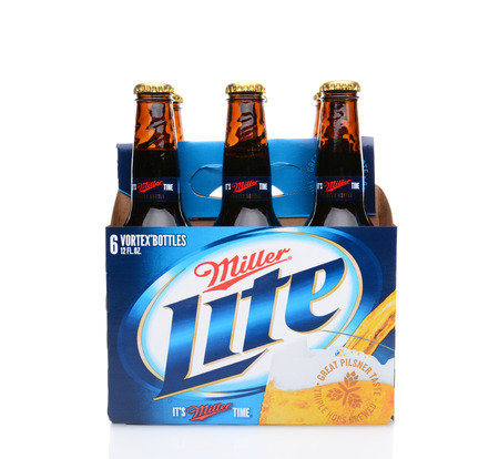 6 pack beer: IRVINE, CA - MAY 25, 2014: A 6 pack of Miller Light beer, side view. Produced by MillerCoors Miller Lite was introduced in 1975 and quickly became the number two brand in America. Editorial