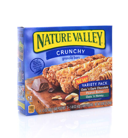 cereal box: IRVINE, CA - May 14, 2014: A 12 count box of Nature Valley Granola Bars. A product of General Mills headquartered in the Minneapolis suburb of Golden Valley, Minnesota.