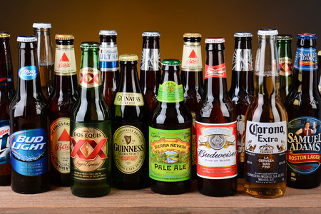 IRVINE, CA - MAY 25, 2014: A variety of popular beer brands. Many brands including domestic and import beers are shown including, Corona, Guinness, Budweiser, Coors Bass and Sam Adams.