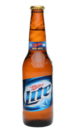 IRVINE, CA - MAY 27, 2014: a single bottle of Miller Light on white. Introduced in 1975 Miller Lite was one of the first Reduced Calorie beers to be successful in the American marketplace.