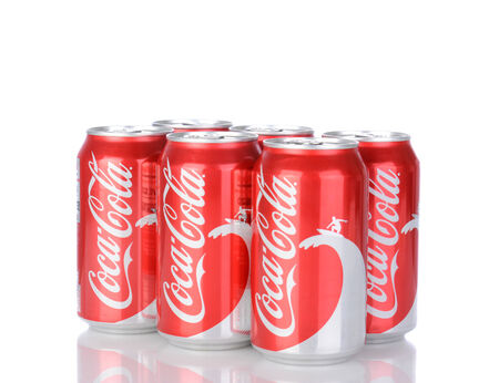 IRVINE, CA - January 05, 2014: A six pack of 12 ounce cans of Coca-Cola Classic, with wave and surfer design. Coca-Cola is the one of the worlds favorite carbonated beverages. Editorial
