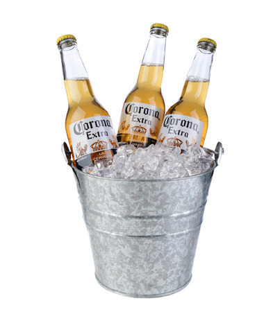beer bucket: IRVINE, CA - January 09, 2014: Three Bottles of Corona Extra in a Bucket of Ice. Corona is the most popular imported beer in the United States.