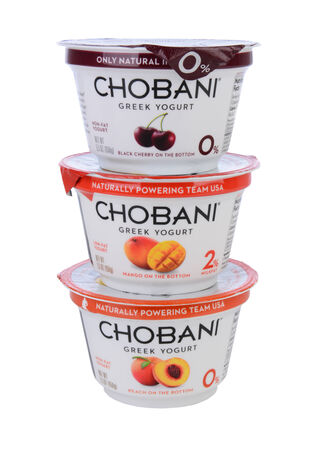 IRVINE, CA - MAY 20, 2014: 3 cups of Chobani Greek Yogurt. Chobani is an American brand launched in 2007 and has become one of the worlds leading yougurt manufacturers.