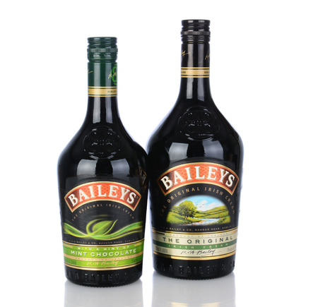 ca: IRVINE, CA - January 11, 2013: A bottle of Baileys Irish Cream and Mint Chocolate Liqueur. Baileys, introduced in 1974, was the first Irish Cream to be brought to market. Editorial
