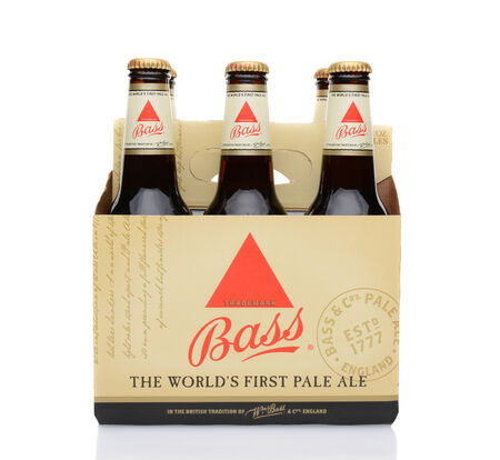 6 pack beer: IRVINE, CA - MAY 25, 2014: A 6 pack of Bass Ale. The Bass Brewery was founded in 1777 by William Bass, in Trent, England is now owned by Anheuser-Busch InBev. Editorial