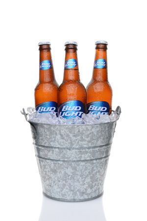 water bucket: IRVINE, CA - MAY 27, 2014: Bud Light bottles in a bucket of ice. From Anheuser-Busch InBev, Bud Light is the top selling domestic beer in the United States.